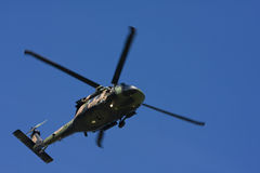 Australian Black Hawk Helicopter. Against a clear blue sky Stock Images