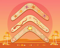 Australian boomerang design. An illustration of an abstract australian landscape with three different designs of boomerang with a hot outback sun royalty free illustration