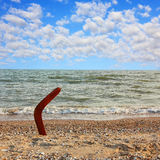 Australian Boomerang on tropical beach against of sea and sky. Royalty Free Stock Photo