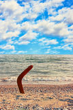 Australian Boomerang on tropical sundy beach. Stock Photo