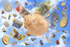 Australian Budget Superannuation Money. Australian money notes, coins and piggy bank falling through the sky Royalty Free Stock Images