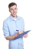 Australian businessman with clipboard Stock Images