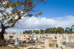Australian Cemetery. The many graves that inhabit a suburban cemtery in Australia Royalty Free Stock Photography