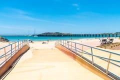 Australian coastal sand beach at Coffs Harbour, Australia. Coffs Harbour, NSW, Australia- December 20, 2017 : Australian coastal sand beach at Coffs Harbour Stock Photo