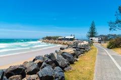 Australian coastal walk and sand beach at Coffs Harbour, Australia. Coffs Harbour, NSW, Australia- December 20, 2017 : Australian coastal walk and sand beach at Royalty Free Stock Image
