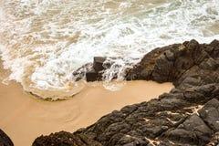 Australian coastline at 'Hat Head'. Coastline at 'Hat Head' (on the east coast of Australia) - foaming ocean waters swirling around and flowing over rocks on Stock Photos