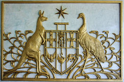 Australian Coat of Arms. Golden Australian Coat of Arms as an emblem on the wall Stock Images