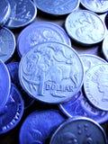 Australian Coins Money Dollar. Australian coins with a blue tone stock photos