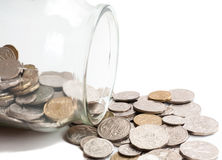 Australian coins spilling out of a glass jar. Collection of Australian coins spilling out of a glass jar on its side, isolated on white Stock Photo
