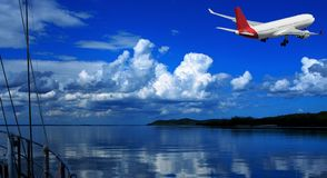 Jet Airliner Flying in an blue coloured cumulonimbus cloudy sky. Australian colourful landscape waterscape scenic view of a commercial passenger jet airliner stock photo