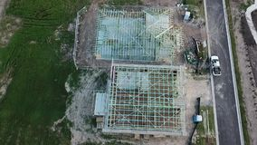 Australian Construction Site Timber Frame aerial view. Aerial view Australian Construction Site Timber Frame gutter guttering home homes house installers kits stock video footage