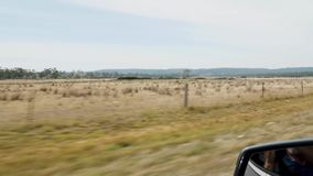 Australian country driving reflection in mirror. Driving at speed alaong an Australian country road driver reflected in mirror stock video