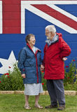 Australian couple in eighties. Wearing red and blue jackets, smiling stock photo