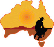 Australian Cowboy. A stylized map of Australia with a silhouette of a rancher or cowboy sitting on a fence looking at the sunset Royalty Free Stock Photos