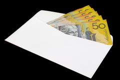 Australian currency. In envelope on black background Stock Photo