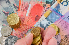 Australian Currency. Hand with Australian banknotes and coins Stock Image