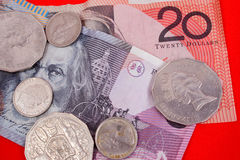 Australian currency. On red background royalty free stock photo