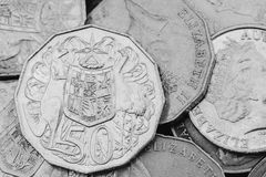 Australian Currency 50 Cents. A pile of Australian Currency 50 Cents pieces in black and white Royalty Free Stock Images