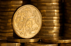 An Australian dollar. Coin with stacks of coins in background Royalty Free Stock Image