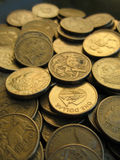 Australian Dollar 3. Lots of one dollar Australian coins royalty free stock photo