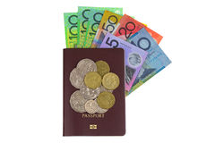 Australian dollar banknote AUD and coins on Passport isolated Royalty Free Stock Images