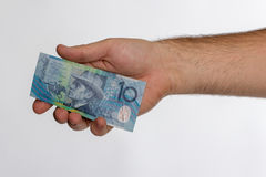 10 Australian dollar Banknote in back hand Royalty Free Stock Images