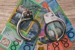 Australian dollar banknotes with handcuffs royalty free stock image