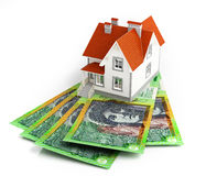 Australian dollar banknotes under house. On white background. 3d rendering Royalty Free Stock Images
