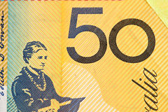 Australian 50 dollar bill fragment closeup showing the number fi. Fty on yellow background stock photography