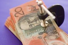 Australian dollar bills. Wad of twenty Australian dollar bills in G-clamp or vice Royalty Free Stock Photos
