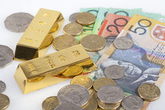 Australian Dollar and gold bars. Australia's banknotes, coins and gold bars stock image