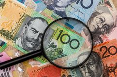 Australian dollar and magnifying glass. royalty free stock photography