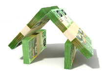 Australian Dollar Notes House Perspective. Stacks of one hundred australian dollar bank notes assembled in the shape of a house on an isolated background Stock Images