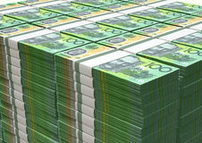 Australian Dollar Notes Pile. A pile of wads of australian dollar banknotes on an isolated background Royalty Free Stock Photos