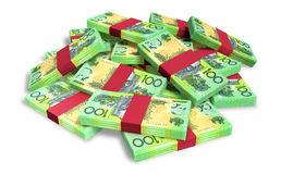 Australian Dollar Notes Scattered Pile. A pile of randomly scattered wads of australian dollar banknotes on an isolated background Stock Image