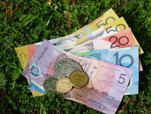 Australian dollars. Notes and coins on the grass Royalty Free Stock Photo