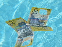 Australian dollars. Australian fifty dollars notes diving in the swimming pool Stock Images