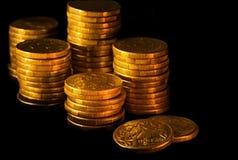 Australian Dollars. Stacks of Australian dollars in golden light, on black background Royalty Free Stock Images