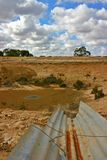 Australian Drought. A farmers dam in Australia. Empty due to drought conditions Royalty Free Stock Images