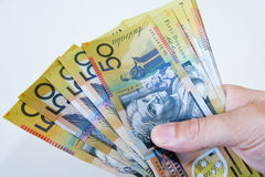 Australian Fifty dollar notes spread in hand. Royalty Free Stock Image