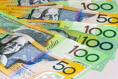 Australian Fifty and One Hundred Dollar bills Fanned. On a flat surface. Copyspace Royalty Free Stock Photo