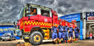 Australian fire truck and firemen Stock Image