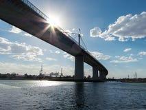 Australian flag atop Westgate Bridge, Melbourne. Stock Photos