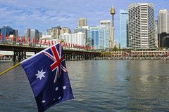 Australian flag and Darling Harbour on Australia Day, Sydney. Australian flag in Darling Harbour on Australia Day, Sydney, Australia Royalty Free Stock Photo