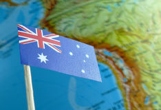 Australian flag with a globe map as a background royalty free stock photo