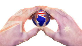 Australian flag hands and glass sphere Royalty Free Stock Images