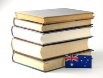 Australian flag with pile of books isolated on white background. Australian flag with pile of books isolated on white Royalty Free Stock Photography