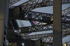 Australian flag through the steel girders of the Sydney Harbor B. Ridge Royalty Free Stock Photos