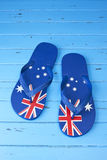 Australian Flag Thongs Background. A pair of Australian Flag Thongs on a blue wood background Stock Photography