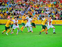 Australian Football Team. Running to attack the on coming cross from a corner. Australia win the match against China 2-0 Stock Image